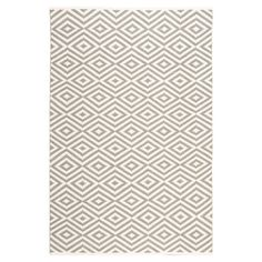 Lend a pop of pattern to your living room or master suite with this eye-catching rug, showcasing a diamond trellis motif in grey.   P...