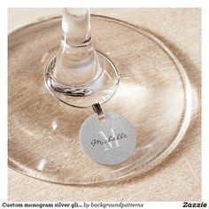 Custom monogram silver glitter wine glass charms Custom monogram silver glitter round wine glass charms. Elegant script typography with monogrammed initial letter. Classy design for fancy wedding party, luxurious bridal shower, engagement, anniversary, birthday etc. Add your own name or family surname. Sparkly faux silvery background texture. Glittery glimmers and sparkling sparkles. Glamorous party accessories and supplies.