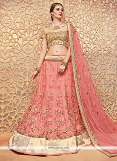 Get going with this majestic and wonderful piece and make your dream attire look richer to your persona. Make the heads turn whenever you costume up with this lovely pink net lehenga choli. The desira...
