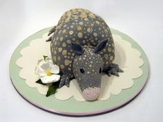 """Inspired by the infamous groom's cake seen in the film ""Steel Magnolias"", this armadillo is also (morbidly) red velvet. He was a birthday cake for a southern belle who has an affinity for both the film... and armadillos. We absolutely love creating cakes that are pretty yet have a sense of humor."""