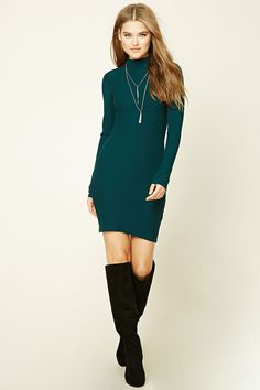 A ribbed knit dress featuring a bodycon silhouette, mock neck, and long sleeves.