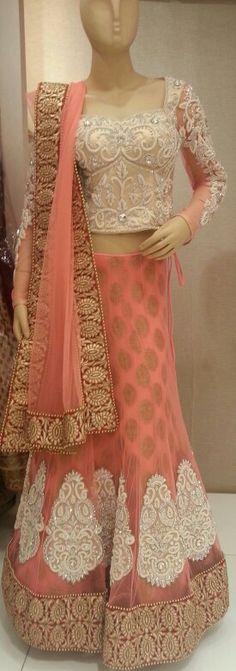 A lehenga is a long, full skirt usually embroidered quite elaborately. It is accompanied by a choli (a fitted blouse) and a dupatta (scarf). This is an elaborate and usually more expensive outfit option Indian Bridal Wear, Indian Wear, Lehenga Choli, Anarkali, Pink Lehenga, Lehenga Style, Bridal Lehenga, Saris, Pakistani Outfits