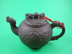 Dragon and Tiger Yixing teapot.