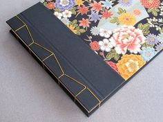 IONA BINDING - Handmade photo album measures 13,58 x 9,64.  Covered with Japanese fabric and black fabric.