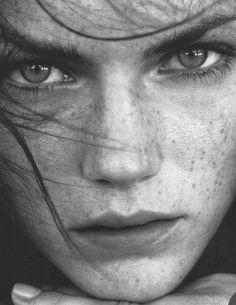 Amelia blue eyes qith freckles and dark brown hair