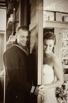 sailor groom and bride hold hands around door ~ throwback thursday ~ late summer backyard wedding inspiration » Abi Ruth