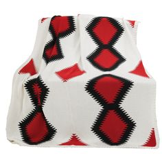 This luxurious Dakota knitted throw has beautiful geometric shapes in black, red, and white. Feauturing a wonderful knitted texture, this throw will be the perfect addition for your home.