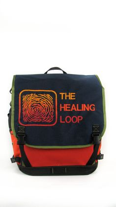 A front view of the waterproof flap top backpack we did for The Healing Loop
