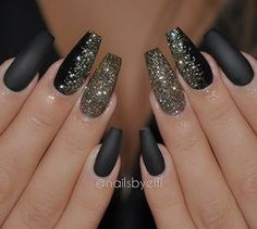 Black nails with gold shimmer