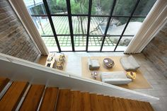 This minimalist home, called a Returning Hut, sits in China just outside the hustle and bustle of city life. The home brings the outside in with the bathroom being built around a natural stone present on the property. In China, Minimalist Kitchen, Minimalist Interior, Xiamen, Contemporary Couches, Bedside Table Design, Wooden Room, Sweet Home, Courtyard Design