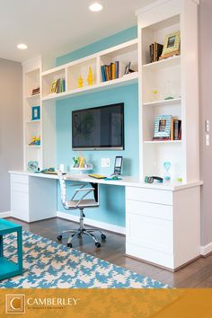 The built-in desk and shelves at One Loudoun are just waiting for you to personalize with colorful accessories. Adding a blue patterned area rug to complement blue walls is the perfect way to brighten this cheerful home office space. #InteriorDesign #Camberley