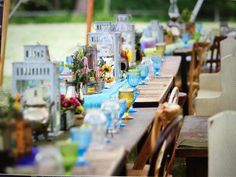 A true country wedding filled with beautiful antique glass and mis matched chairs and various tables under a beautiful tent. As the sun set over the river, guests danced to a quartet and shared toasts.