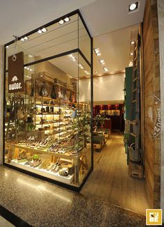 """In this particular project for Outer BarraShopping, Rio de Janeiro, Kube used demolition wood for the floor, a """"Terracor"""" texture that is similar to clay for the walls, container´s metal sheets for the cashier and the wall behind it, combined with elements from the gardening universe for decoration and reinforcement of the concept."""