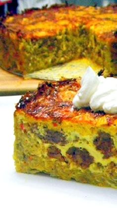 Quiche Cake with a Hash Brown Crust... BIG THICK DELICIOUS man sized QUICHE  Loaded with sausage and spices and even comes with a HASH BROWN crust!
