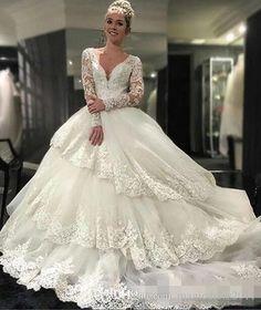 Fantastic 2016 New Sexy White Long Sleeve Beaded Lace Tulle Ball Gown  Wedding Dress Bridal Gown vestido de noiva robe de mariage b119296b9e17