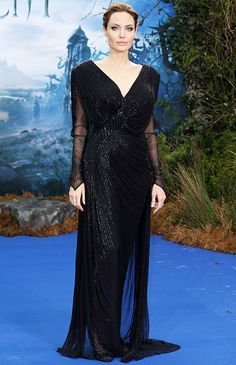 Angelina Jolie wears a long sequined Atelier Versace black gown with an open back to a Maleficent event in London May 8