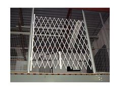 Folding gate for Access Control - Glassessential.com  http://www.glassessential.com/security-scissor-folding-gate  #folding #foldinggate #expandable #collapsible #security #expandablegate #collapsiblegate #securitygate #storefront #patio #divider #enclosuer #storage
