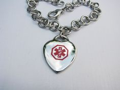This beautiful bracelet is a very elegant way to wear your medical alert! The insignia is factory engraved and enameled on the front of the heart charm. This bracelet is made entirely of stainless steel - sturdy enough for continuous wearing.