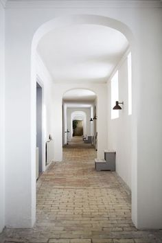 hallway with vintage lighting and arched doorways