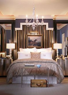 + Love the violet wall color against ivory crown moulding + No brass/gold, so the draped material behind bed could be a champagne/blush, ivory or lavender, lamp bases in silver or nickel + chandelier is subtle and conservative, small in size