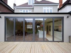 Rear extension with folding doors House Extension Design, Glass Extension, Roof Extension, Extension Google, Extension Ideas, Conservatory Extension, Single Storey Extension, Moderne Pools, Glass Balcony