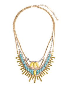 Add a tropical touch to your neckline with tiered layers of yellow, teal and light blue stones and crystals. About the Necklace: Total length is 15, with a 3 extender, a 7 neck drop and lobster clasp closure.
