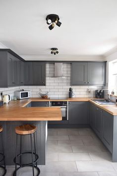 Budget kitchen reveal before and after photos. Small kitchen with dark cabinets.