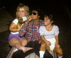 Michael Jackson drinking a bottle of vodka with 2 midgets