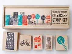Buy or make city stamps - to make, use craft foam on flooring sample blocks with long rectangles for bases and triangles, domes, etc for roofs