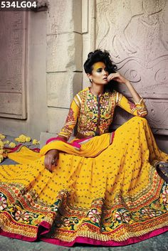 #Yellow #georgette #lehenga crafted with stone, zari, resham embroidery, lace and patch border work with embroidery work on choli. Green art silk choli with yellow georgette sleeves and yellow net dupatta available with this.Price US $ 197