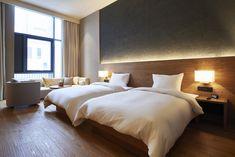 "Muji offers first look inside its ""anti-cheap"" hotel in Shenzhen"