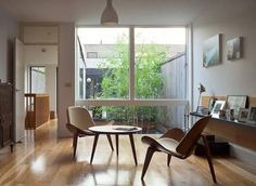 Image result for wagner shell chair in living room