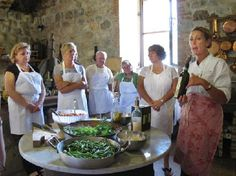 Ecco La Cucina: Gina explains Chianti Classico wine during a cooking session at the old mill kitchen (Cooking School in Siena)