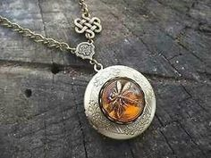 Celtic dragonfly in amber. How perfect for the outlander series.  (Ebay)