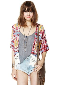 Don't know how warm this would keep you (well, I'm a mom!) but if you're think kimono this is interesting. MinkPink Combi Garden Kimono
