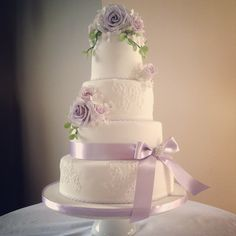 Lavender and lilac rose bloom wedding cake