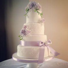 Lavender and lilac rose bloom wedding cake