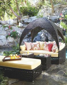 Curl up comfortably and escape to the inner sanctum of our Bali Daybed. Cooling breezes flit in and out of the uniquely woven hideaway with cathedral-domed canopy.  | Frontgate: Live Beautifully Outdoors