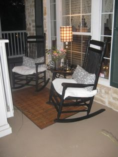 Beautiful white porch with black rocking chairs~