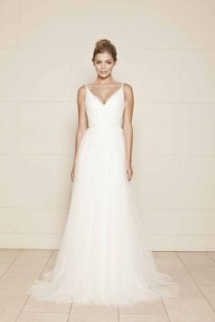 Lisa Gowing -- ISABELLE  V neckline with fine shoestring straps, ruched tulle cross-over bodice and low V back. Soft tulle skirt has sweeping train. Satin ribbon waist bow. Made to order from $4390. Ready-to-wear $3390