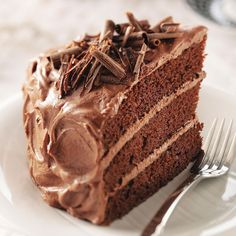 Best Chocolate Cake Recipe -With a tender crumb and rich frosting, a layered chocolate cake always impresses, no matter the occasion. One bite and you'll agree this cake recipe is awesome! —Elvi Kaukinen, Horseheads, New York