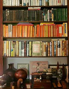 To streamline the appearance of her library, Hicks organizes books by color.