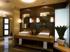 Love the vanity design:  a thick top with a towel rack beneath and a shelf for storage.