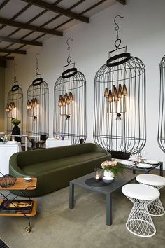 The Home Delicate Restaurant Interior Design by Logica:architettura - Possible overkill with the birdcages on the walls - I think I would have personally just gone for 1 ......