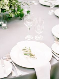 Elegant table setting, natural linens with white and green floral centerpieces | Sonoma Wedding