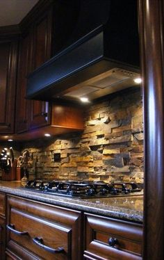 Modern Kitchen Real Estate Luxury... stone backsplash, beveled granite, dark cabinets with under cabinet lighting.