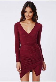 We are crushing over burgundy this season here at Missguided with this hot bodycon dress. With long sleeve, slinky fabric, cross over neckline and hem finish with a fiercely feminine ruched side gathering detail which will give you a seriou...