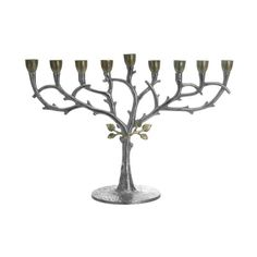 An exquisitely artful piece, this handcrafted Silver Branch with Gold Leaves Menorah is a stunning addition for your home. Created in fine, hammered stainless steel by skilled artisans, the design is completely captivating: delicate, curving silvery branches rise to offer gleaming candleholders, while tiny gold-toned leaves seem to unfurl at the top of the trunk rising from the base. An important piece that has been fancifully reimagined with an inventive, modern eye, this menora...