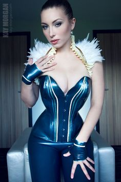 Electric blue corset with contrasting white and blue stripes running down the front, paired with matching leggings and wrist gloves.
