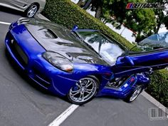 Mitsubishi 3000 GT  -- I think this one is pretty slick.  I love lambo doors too.. I want them on my mustang also one day lol